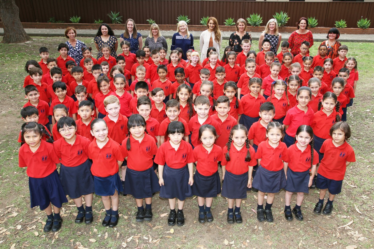 All students standing on school oval for 2017 photo.