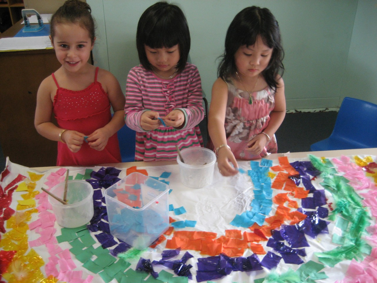 Preschool children enjoying painting.